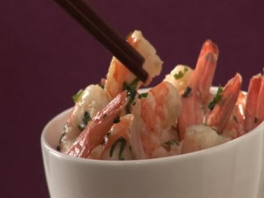 Taking prawns out of a bowl — Wideo stockowe