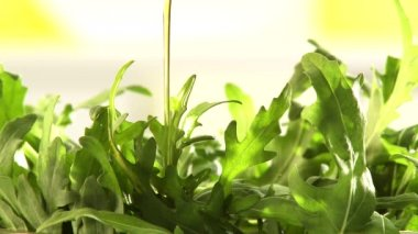 Sprinkling salad with oil — Stock Video