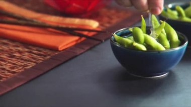 Sprinkling steamed soya beans — Stockvideo