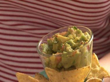 Dipping nacho in guacamole — Stock Video