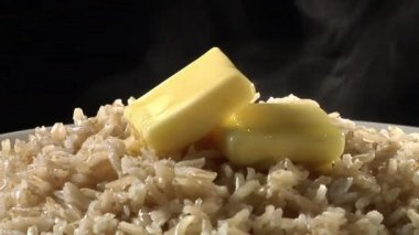 Rice with knobs of butter — Stock Video