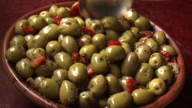 Taking a spoonful of olives — Stock Video