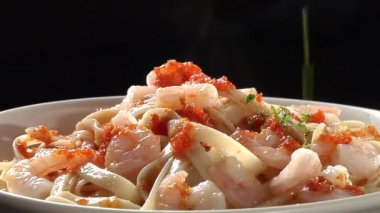 Ribbon pasta with prawns — Stock Video
