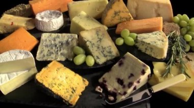 Cutted cheeses on platter — Stock Video