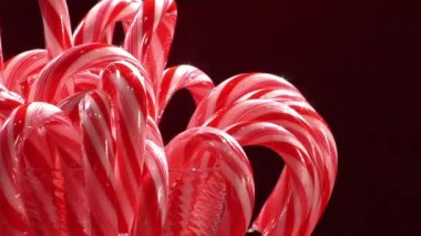 Red and white striped candy canes — Stock video