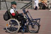 Man in special wheelchair — Stock Photo