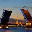Peter and Paul fortress in the target separated Palace bridge on Neva river in Saint Petersburg during the white nights against the red sunset. — Stock Photo #77316932