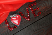 Word love maid out red stones — Stock Photo