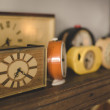 Old clocks on a shelf with oldschool vintage instagram filter — Stock Photo #68725017