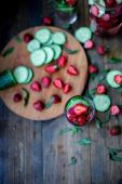 Strawberry mint cucumber infused water decorated in rustic style on dark wood table background — Stock Photo