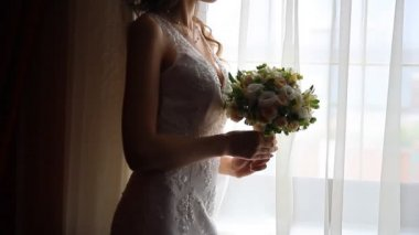Bridal bouquet of flowers in hands of the bride — Stock Video