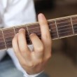 Hands playing acoustic guitar, dolly shoot — Stock Video #74466517