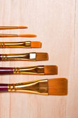 Varieties of painting brush on the wooden background. — Stock Photo