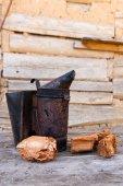 Old smoker at beehive — Fotografia Stock