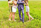 Bridesmaids with groom — Stock Photo