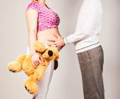 Pregnant woman with husband and toy — Stock Photo