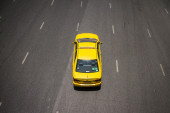 Yellow taxi on highway — Stock Photo