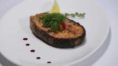 Baked steak of salmone rotating On White Background — Stock Video