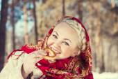 Russian woman in a red scarf — Stock Photo