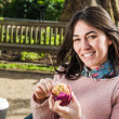 Beautiful Woman Having a Muffin Outside at the Coffee Shop — Stock Photo #66606711