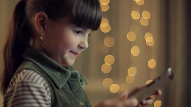Young girl holding a tablet — Video Stock