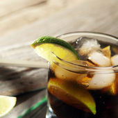 Cocktail with cola and ice — Stock Photo