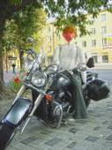 Portrait of a doll on a motorcycle — Stock Photo