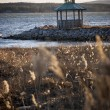 Wooden gazebo on the shore of Lake photographed at sunset — Stock Photo #71645131