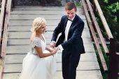 Wedding couple on the background of bridge — Stock Photo