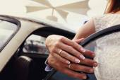 Bride and groom put their hands together and show the rings — Stock Photo