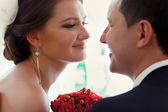 Wedding couple looking at each other — Stock Photo