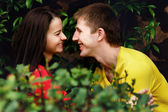 Loving couple in the garden of the Vatican Museum in Rome Italy among bushes — Fotografia Stock