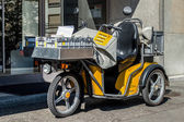 Switzerland, Geneva - June 2015. Swiss post delivery motorcycle on the street in the city center of Geneva. Swiss post is a public company owned by the Swiss Confederation — Stock Photo