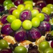 Постер, плакат: Fragment of fruity cake with grapes in jelly with syrup