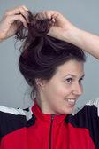 Girl preen own hair — Stock Photo