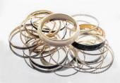 Lot of golden bracelets — Stock Photo