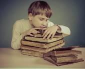 The Boy asleep on old books — Stock Photo