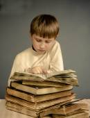 The Boy reading a vintage book — Stock Photo