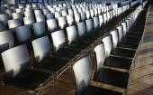 Rows of empty chairs prepared for an indoor event — Stockfoto