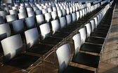 Rows of empty chairs prepared for an indoor event — Stock fotografie