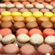 Assorted french multicolored macaroons on table — Stock Photo #68230059