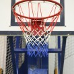 Basketball hoop in a high school gym — Stock Photo #75344397