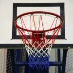 Basketball hoop in a high school gym — Stock Photo #75344405