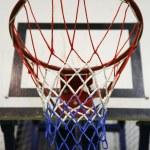 Basketball hoop in a high school gym — Stock Photo #75344415