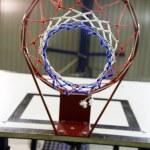Basketball hoop in a high school gym — Stock Photo #75344471