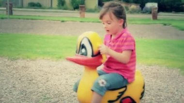 Girl  plays on toy at park — Stock Video