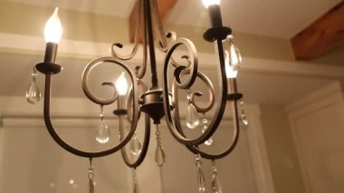 Beautiful chandelier in dining room — Stock Video