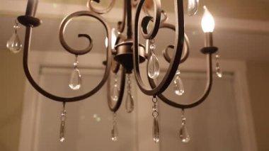 Beautiful chandelier in dining room — Stock Video