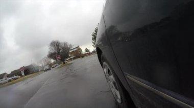 Car driving through parking — Stockvideo