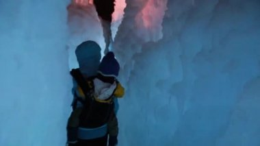 Mother and  baby in the ice castle — Stockvideo